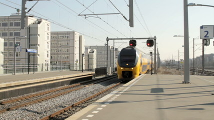 Train arriving in Amsterdam the Netherlands