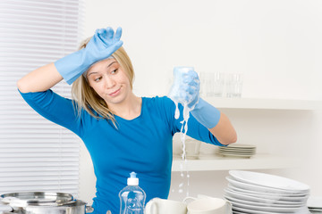 Modern kitchen - frustrated woman washing dishes