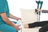Doctor Bandaging Ankle poster