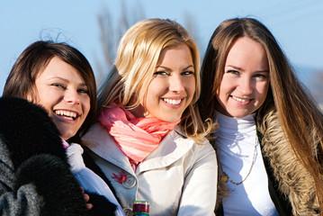 Happy three beautiful young women