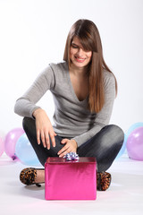 Beautiful happy young woman with birthday gift