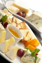 Cheese plate with grapes and honey