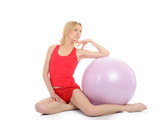 Pretty sporty fitness woman doing exercise with pilates ball. is