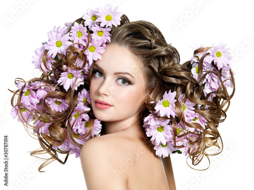 Flowers in long hair of beautiful and sexy woman