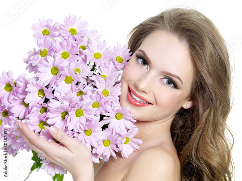 Happy woman with spring purple flowers