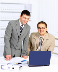 Two handsome businessmen working together on a