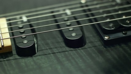 detail of electric guitar, pickups and cords