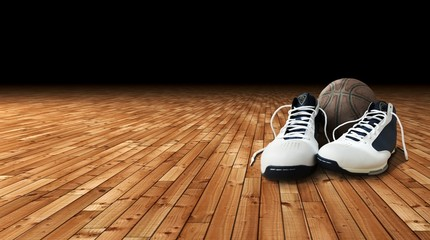 Basketball shoes and ball on the court