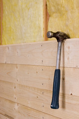 Hammer hanging on a wall wich are beeing built
