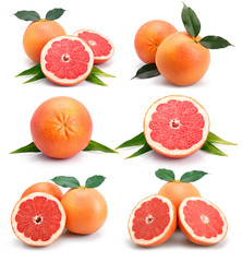 Set of grapefruit fruits with cuts and green leaf isolated