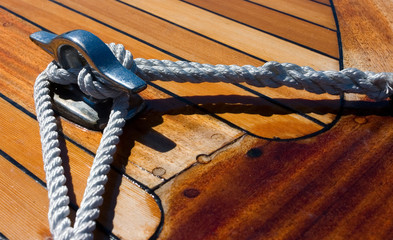 Close up on knot detail on wooden boat