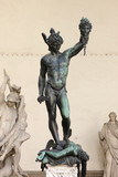 Perseus holding head of Medusa poster