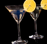 Martini glasses on black background