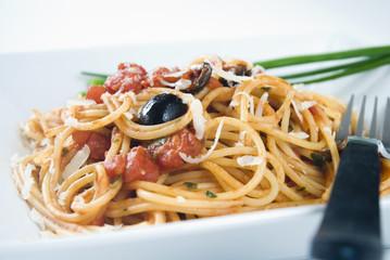 Spaghetti Puttanesca,a traditional italian recipe.