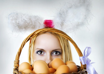 easter bunny woman looking over eggs basket
