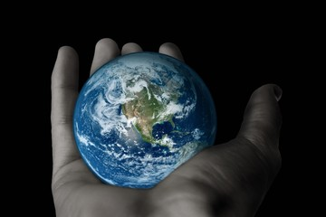 Man hand holding model of earth .