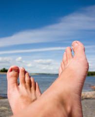 Feet at the beach sunbathing
