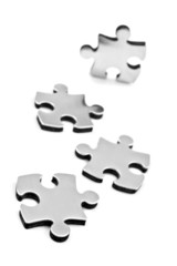 Stainless steel puzzles pieces on white background