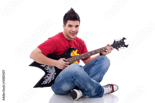 seated guitarist playing