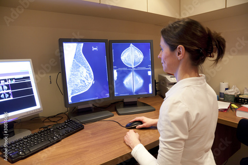 Radiology technician looking at mammography