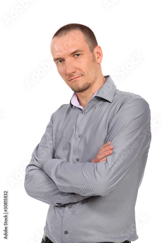 Portrait of handsome businessman in gray shirt standing