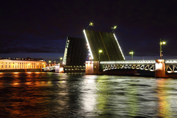 Palace Bridge drawbridge on Neva river at night.