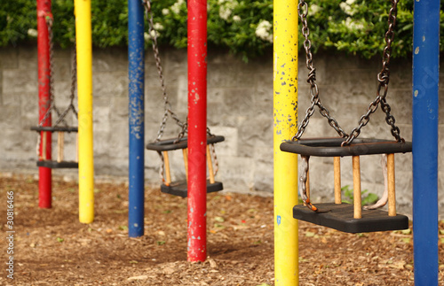 three empty teeter with chains