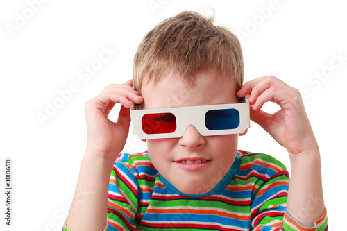 little concentrated boy in striped shirt and anaglyph glasses