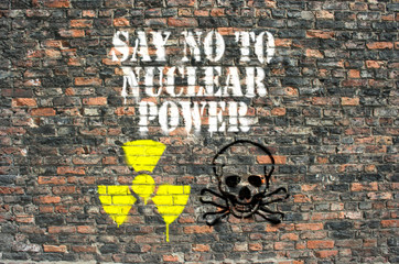 Say no to nuclear power sprayed on brick wall