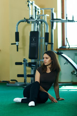 brunette woman in a gym yoga