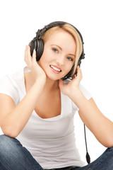 happy teenage girl in big headphones