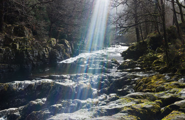 sunlight on rocky waterfall