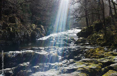 sunlight on rocky waterfall