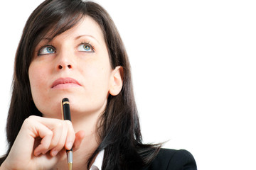 Young businesswoman thinking with pen on her chin