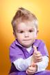 Little cute boy showing ok sign