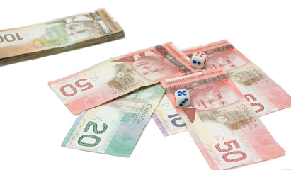 Canadian dollars with dice
