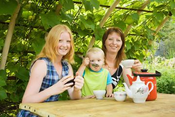 mother with children having tea