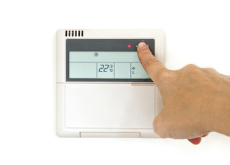 Main sur un thermostat