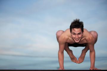 Happy Young Man Doing Yoga