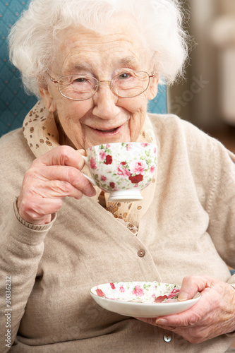 Senior Woman Enjoying Cup Of Tea At Home - 30836232