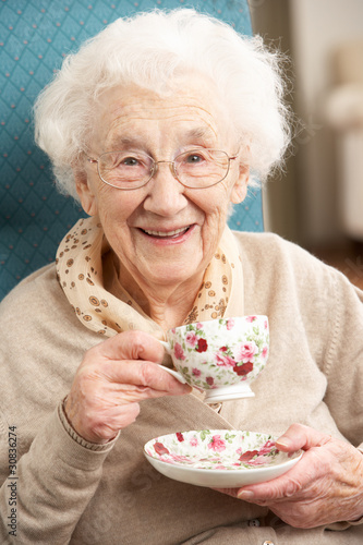 Leinwandbild Motiv Senior Woman Enjoying Cup Of Tea At Home
