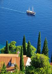 wooden boat blue sea