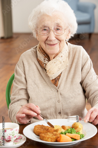 Senior Woman Enjoying Meal - 30839417