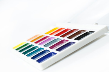 watercolour paints on a white background