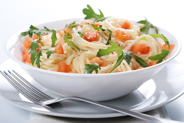 Pasta with tomato and rucola