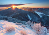 Frosty sunset panorama in beauty mountains