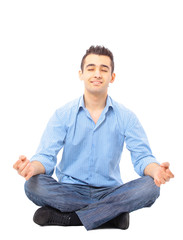 Portrait of young man meditating in a lotus position