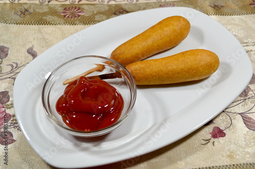 Two Corndogs with Catsup