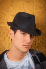 Young male model wearing hat, close up