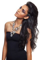 beautiful woman with long curly hair and flower necklace.